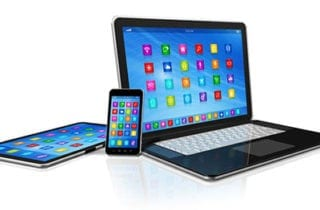Laptop, phone and tablet with apps